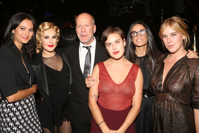 "NEW YORK, NY - SEPTEMBER 21: (EXCLUSIVE COVERAGE) (L-R) Emma Heming, Rumer Willis, father Bruce Willis, sister Tallulah Belle Willis, mother Demi Moore and sister Scout LaRue Willis pose backstage as Rumer makes her broadway debut as ""Roxie Hart"" in Broadway's ""Chicago"" on Broadway at The Ambassador Theater on September 21, 2015 in New York City. (Photo by Bruce Glikas/FilmMagic)"